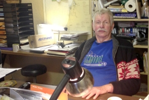 Joe Peterson sits at his desk in the Garfield Center Building, est. 1948. Peterson has been a Parkland resident for 21 years. Photo by: Cassady Coulter